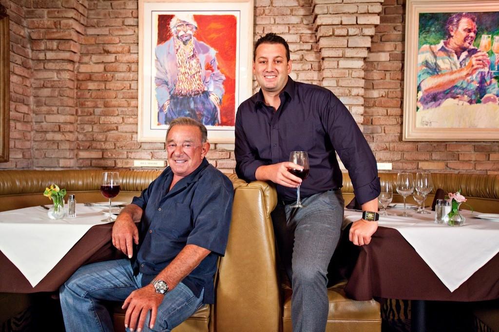 Freddie Glusman (seated) with Evan Glusman are Pieo's Owners