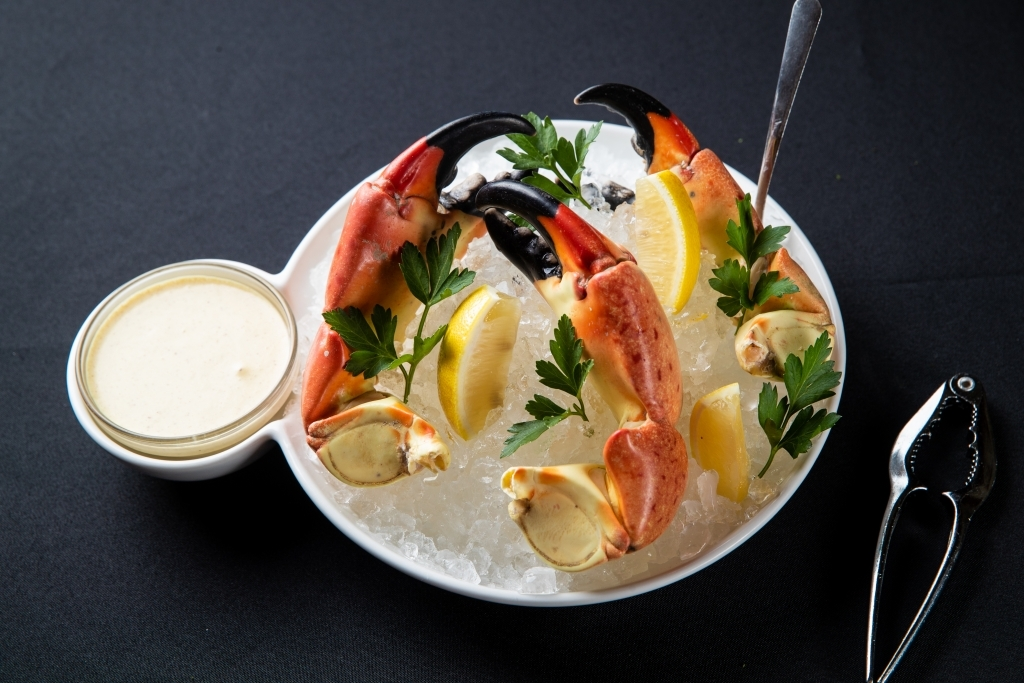 Fresh stone crab with dipping sauce at Piero's