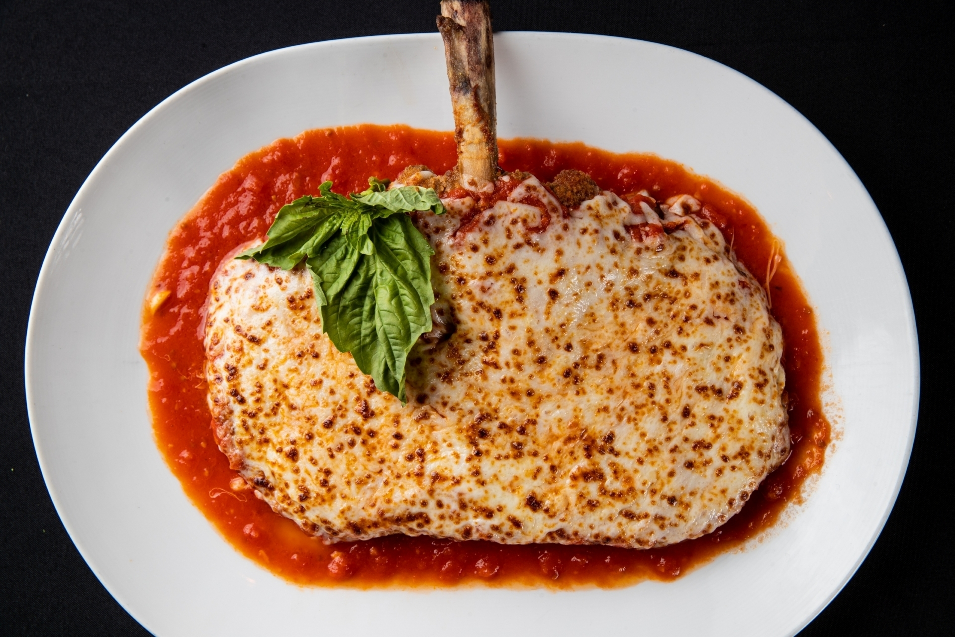 Piero's Classic Cheesey Veal Chop Parmesan