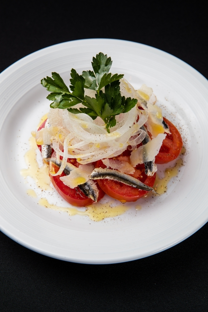 Fresh anchovy salad with tomato and blanched onion