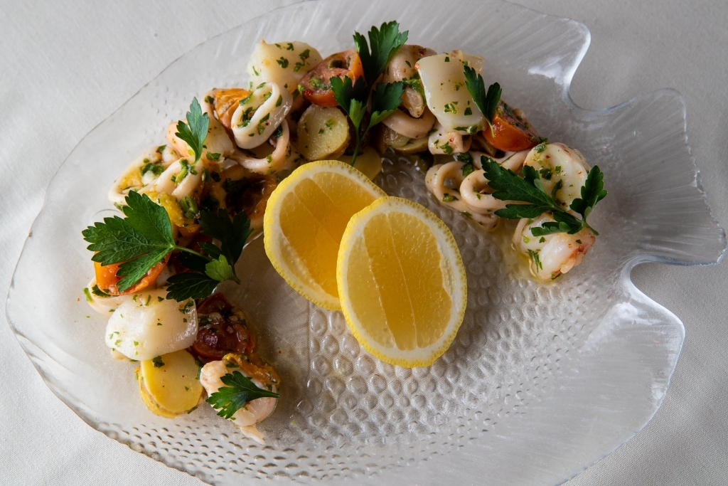 Piero's Italian Cuisine Seafood Salad is searved with fresh crab, scallops, shrimp and seasonal seafood
