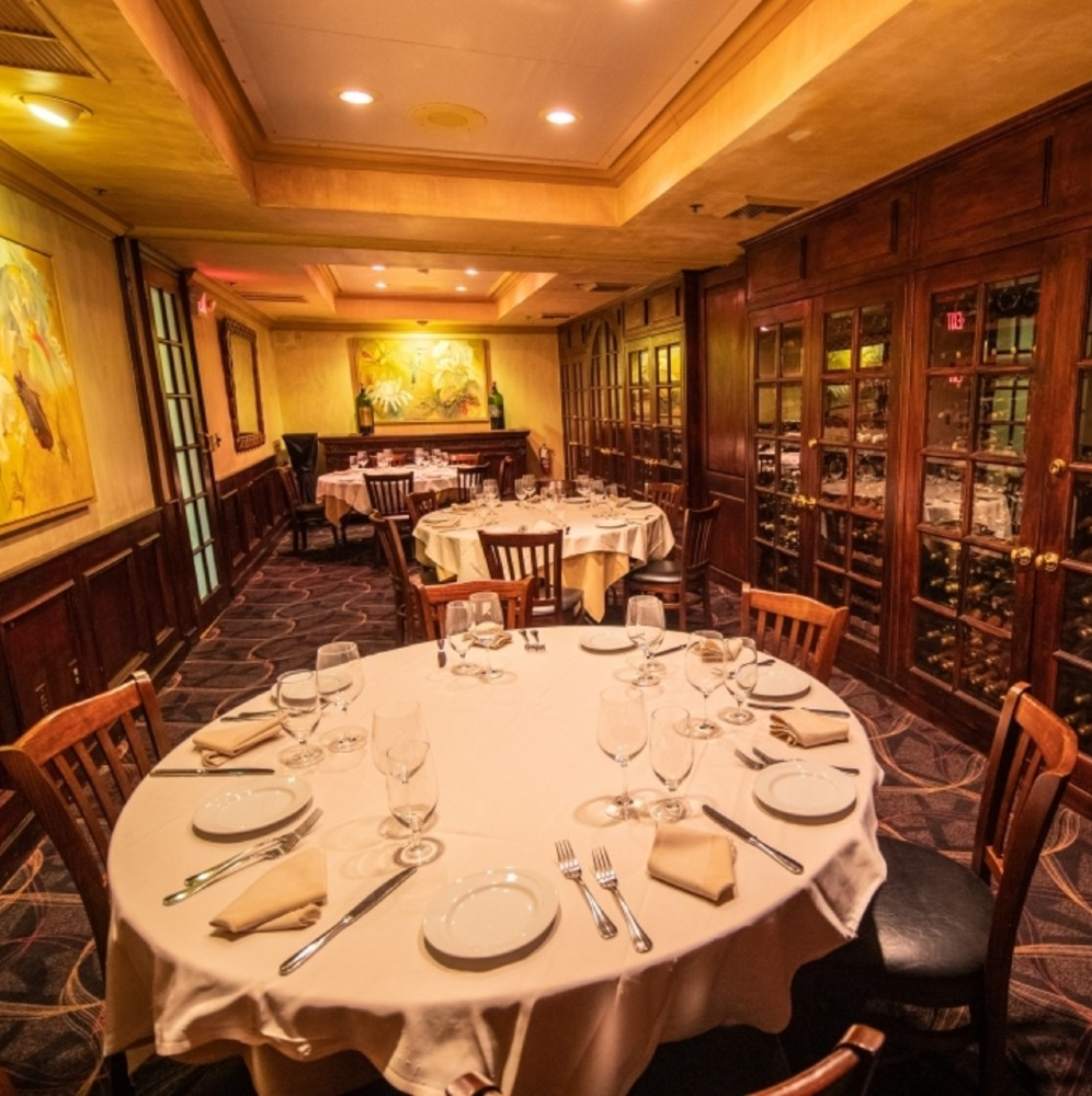 Wine cellar room with round tables. A private dining favorite at Piero's Italian Cuisine.